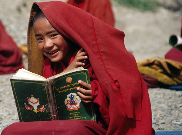 boy monk reading smile