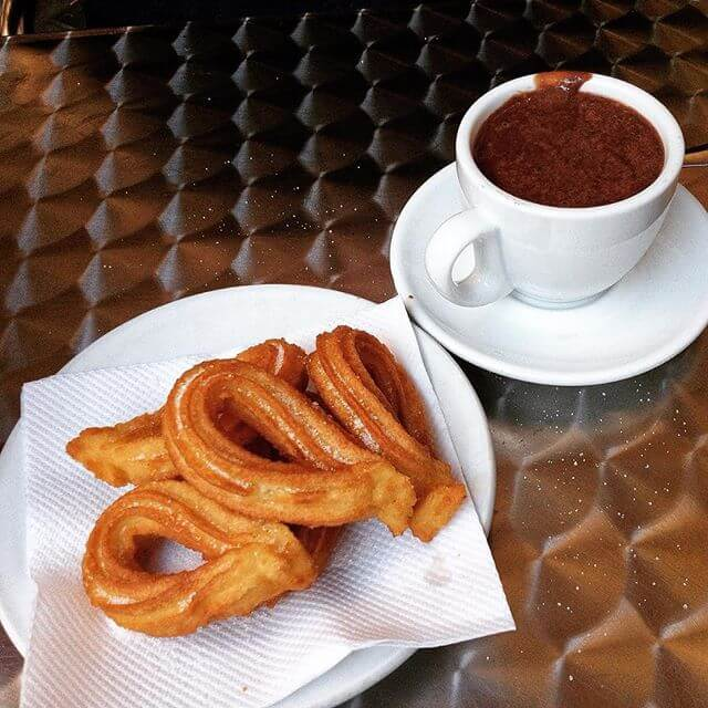 plate of churros and hot chocolat barcelona