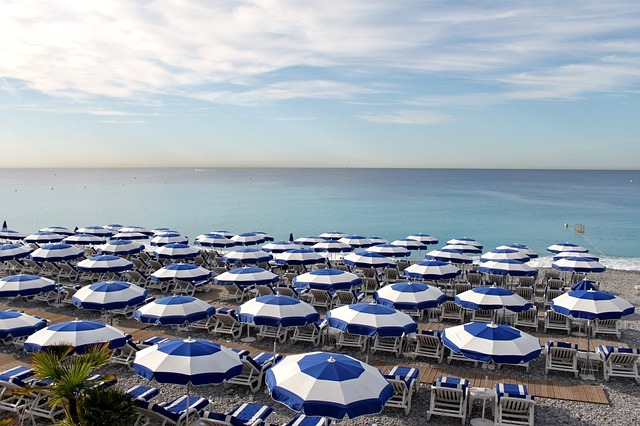 rows of beaches umbrella french riviera beach nice