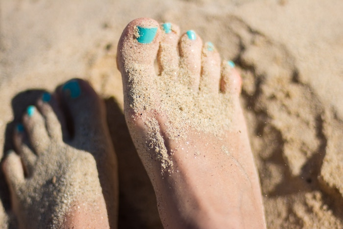 feet in sand blue toes beaches