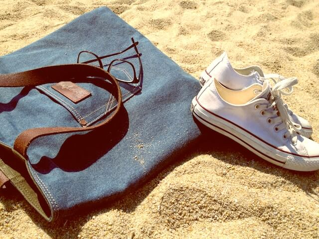bag and sneakers on sand nice