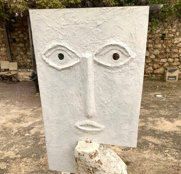 white concrete sculpture eyes