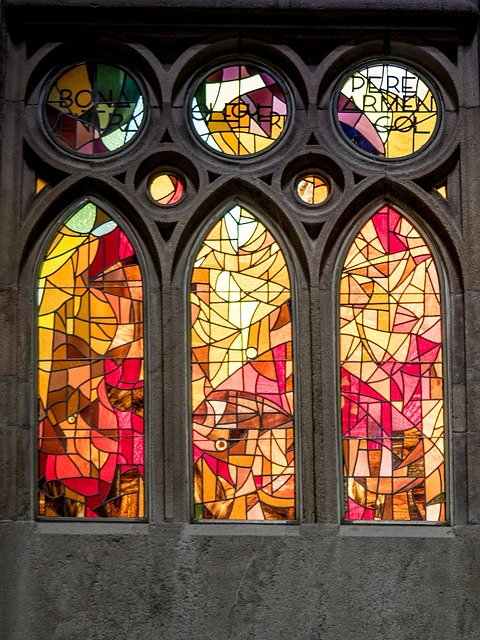 travel-barcelona-sagrada-stainglass window in tones of yellow and red