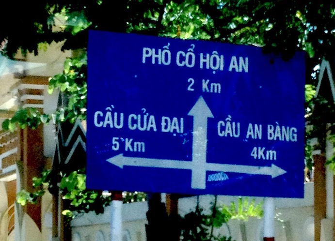 blue sign beach hoian