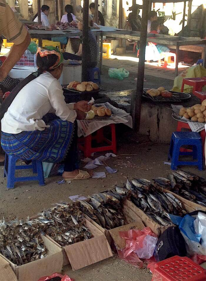 woman sitting selling fish Paco Mai Chau