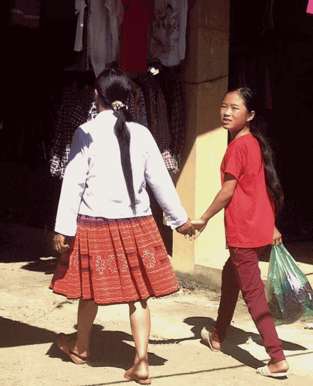 2 girls holding hands paco mai chau