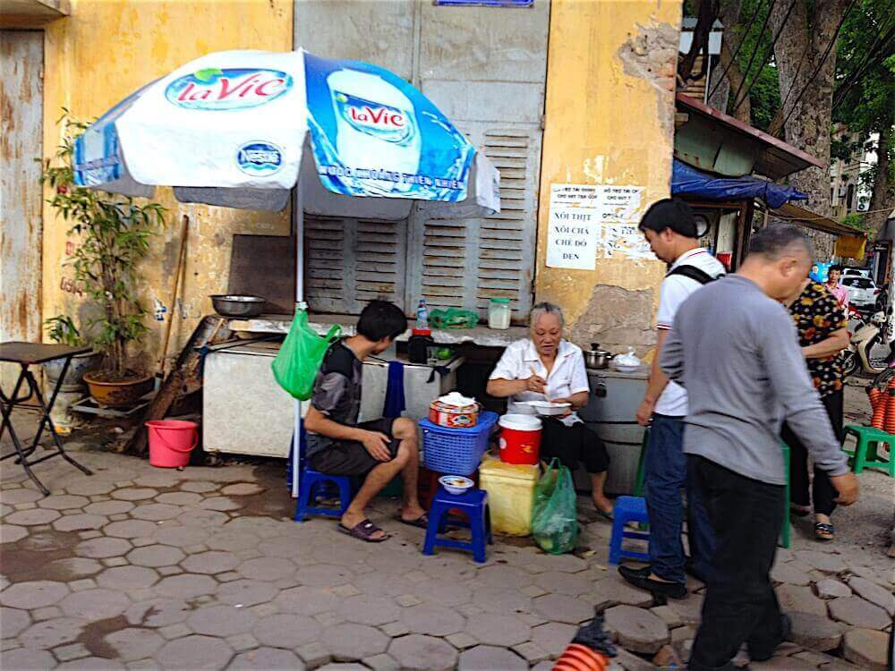 Hanoi street food umbrella image urbanpax