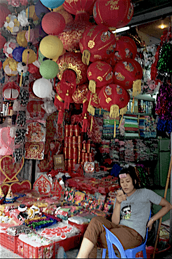 souvenir shop with woman outside hanoi