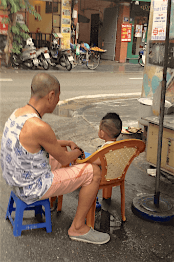 man and boy sitting