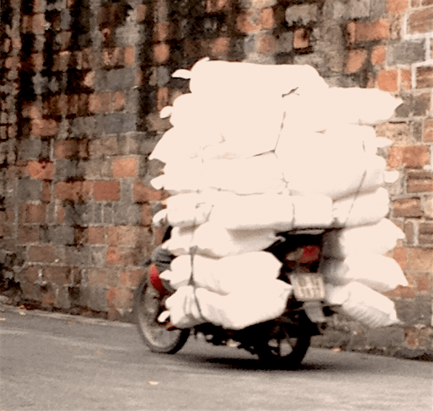 stack of white bags on bike