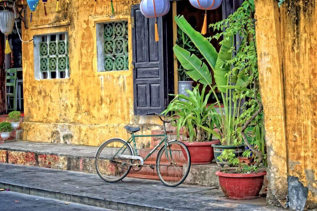 yellow house with plants hoi an