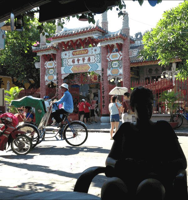 temple in background and silhoutte hoian