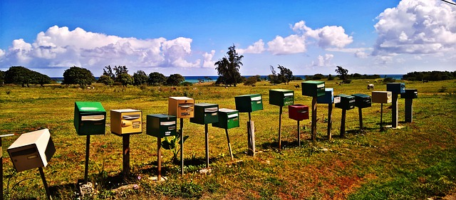 various mailbox in a green field