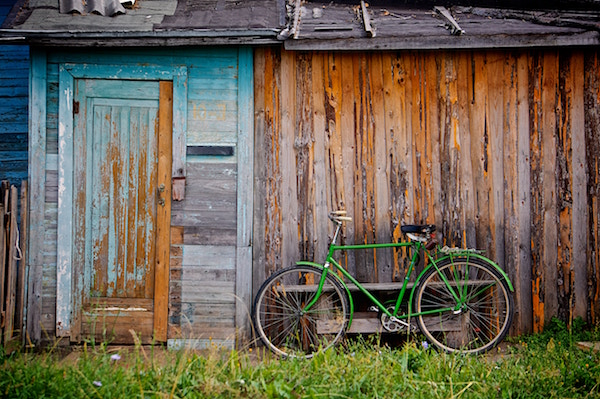 life travel old wooden front door with bike nature