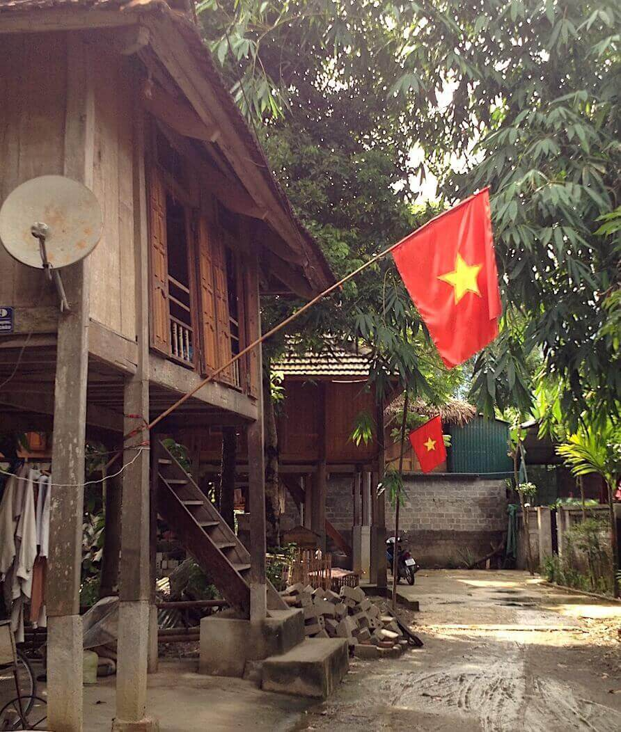mai chau traditional house with flag
