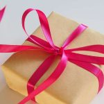 gift giving paper red bow