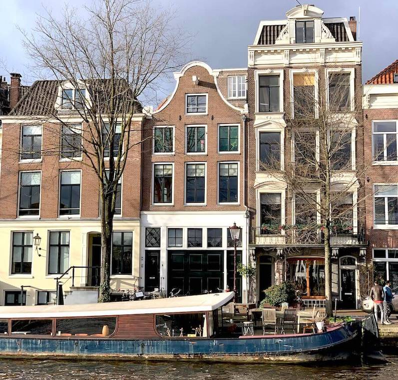 amsterdam building with houseboat